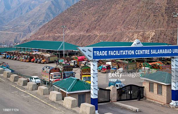 Pakistani vehicles unload their goods at the trade facilitation centre in the border area near Uri on January 11 2013 in Salamabad 120 km northwest...