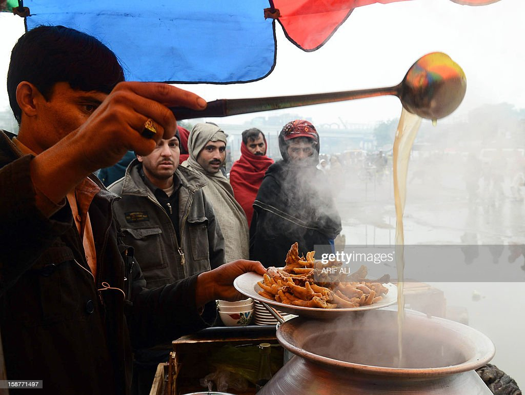 A Pakistani vendor prepares soup at the road side in Lahore on December 28, 2012. High food prices have derailed ambitious aims to slash extreme poverty and hunger across the world by 2015, a World Bank and International Monetary Fund report said.