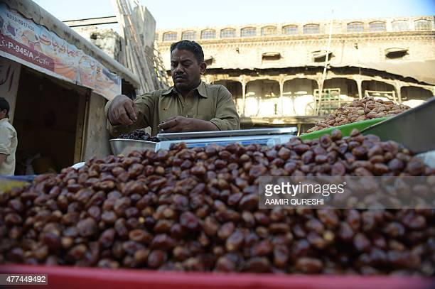 A Pakistani vendor sells dates along a street in preparation for the Muslim fasting month of Ramadan in Rawalpindi on June 17 2015 More than 15...