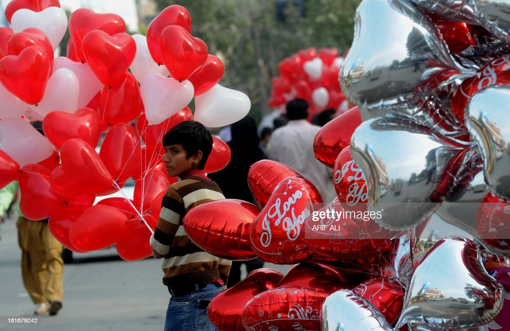 A Pakistani vendor sells heart shaped balloons on Valentine's Day in Lahore on February 14, 2013. Pakistan's media regulator Wednesday asked television and radio stations to avoid offending religious sentiments and corrupting the nation's youth in their Valentine's Day broadcasts. AFP PHOTO/Arif ALI