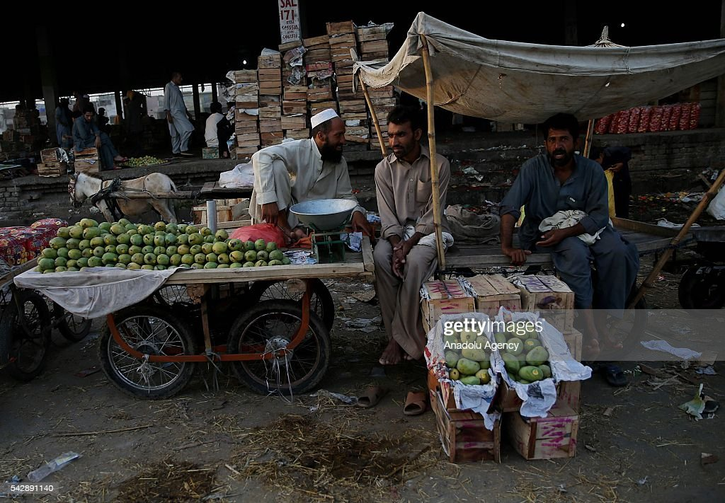 Pakistani vendors work in the morning at fruit and vegetable market in Islamabad, Pakistan on June 25, 2016.