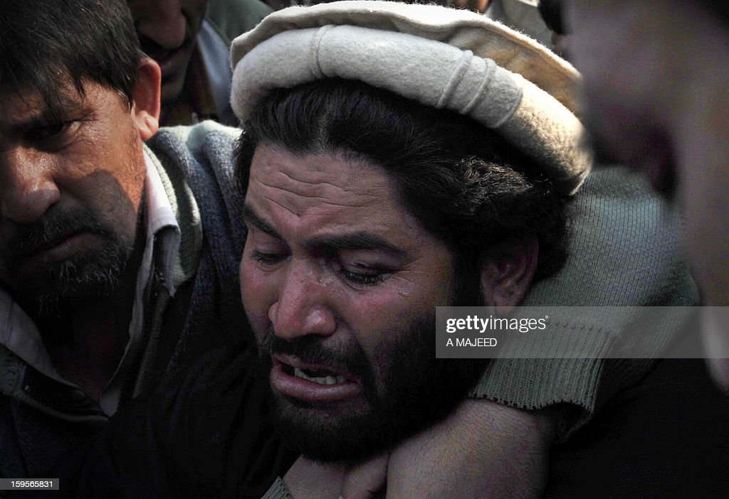 A Pakistani villager from the northwest mourns the death of a relative during a protest in the provincial capital Peshawar on January 16, 2013. Demonstrators said gunmen wearing military uniforms stormed homes in Bara Tehsil in Khyber Agency, some 30 kilometers from Peshawar and shot 18 villagers dead in an overnight raid. AFP PHOTO/A MAJEED
