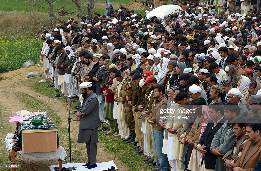 Pakistani villagers and military personnel offer funeral prayers for a Pakistani soldier who was shot dead along the Line of Control (LoC), at a village in Bainso, about 45 kms from the capital Islamabad, on February 16, 2013. Indian troops shot dead a Pakistani soldier along the de facto border in the disputed Kashmir region in the first deadly exchange since a truce was agreed a month ago, officials said Friday. AFP PHOTO/Farooq NAEEM