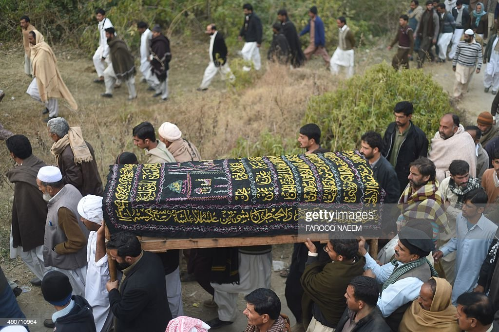 Pakistani villagers carry the coffin of army commando Arshad Mehmood, who was convicted for his involvement in a 2003 assassination attempt on former military ruler General <a gi-track='captionPersonalityLinkClicked' href=/galleries/search?phrase=Pervez+Musharraf&family=editorial&specificpeople=121550 ng-click='$event.stopPropagation()'>Pervez Musharraf</a>, for his funeral in Javera village around 60 km from Islamabad on December 20, 2014, after his execution in Faisalabad. Rights groups December 20 condemned Pakistan's decision to hang two convicted militants in its first executions for six years, as leaders vowed decisive action in the wake of a Taliban school massacre that left 149 people dead. AFP PHOTO / Farooq NAEEM