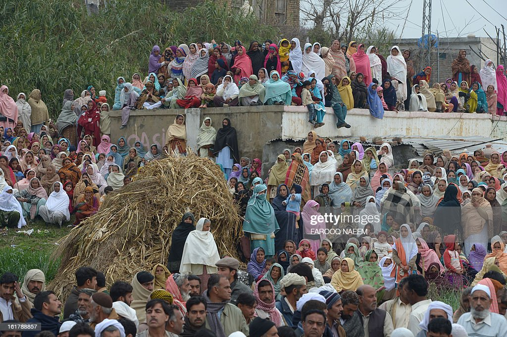 Pakistani villagers gather for the funeral of a Pakistani soldier who was shot dead along the Line of Control (LoC), at a village in Bainso, about 45 kms from the capital Islamabad, on February 16, 2013. Indian troops shot dead a Pakistani soldier along the de facto border in the disputed Kashmir region in the first deadly exchange since a truce was agreed a month ago, officials said Friday. AFP PHOTO/Farooq NAEEM