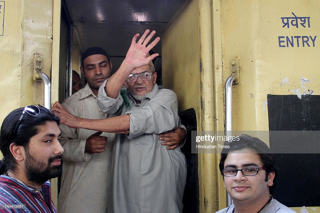 Pakistani Virologist Khalil Chishti waves to his relatives from the train at Railway Station before leaving for New Delhi on way to Pakistan on May 14, 2012 in Ajmer, India. 82-year-old Chisti is facing a life sentence in a murder case and on May 10 was permitted by the Supreme Court to visit Pakistan for a temporary stay. He will return his homeland after spending 2 decades in India.
