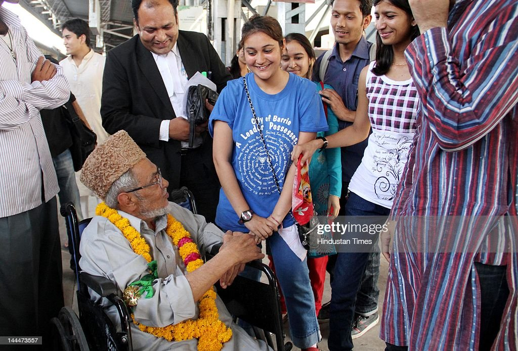 Pakistani Virologist Khalil Chishti with his relatives at Railway Station before leaving for New Delhi on way to Pakistan on May 14, 2012 in Ajmer, India. 82-year-old Chisti is facing a life sentence in a murder case and on May 10 was permitted by the Supreme Court to visit Pakistan for a temporary stay. He will return his homeland after spending 2 decades in India.