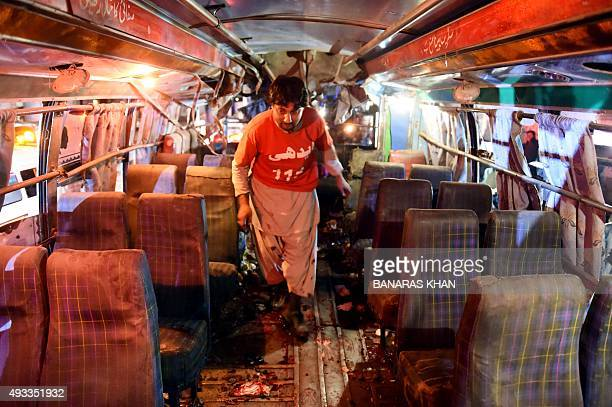 A Pakistani volunteer searches a bus after a bomb explosion in Quetta on October 19 2015 At least 10 people were killed and several others wounded on...