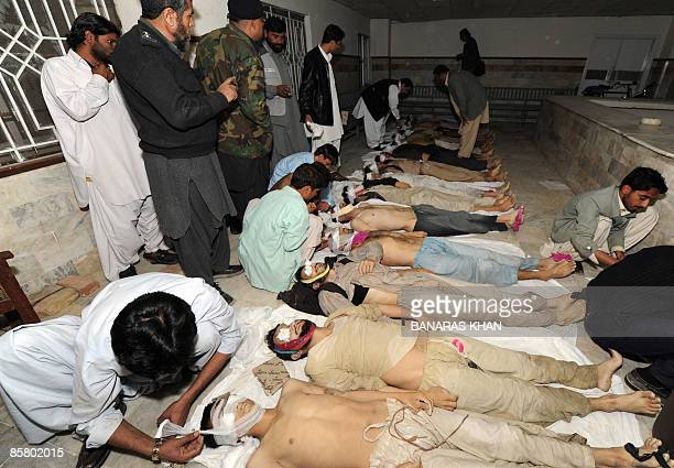 Pakistani volunteers and hospital employees prepare and tag the corpses of some 46 Afghans at a hospital in Quetta on April 4 2009 after the bodies...