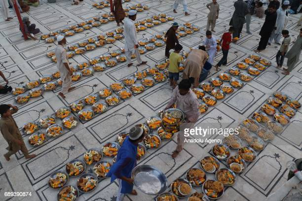 Pakistani volunteers arrange food for Muslims at a sahn of a mosque during the first day of the holy month of in Karachi Islamabad Pakistan on May 28...