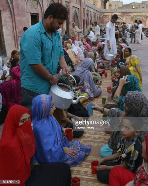 Pakistani volunteers distributing Iftar foods before breaking their fast on the fifth day of the holy month of Ramzanulmubarak food among the...