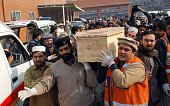 Pakistani volunteers move the coffin of a student from a hospital following an attack by Taliban gunmen on a school in Peshawar on December 16 2014...