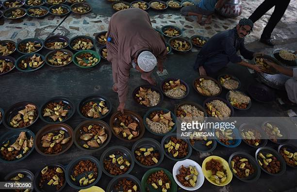 Pakistani volunteers prepare Iftar food for devotees to break their Ramadan fast in Karachi on July 1 2015 Ramadan is marked by Muslims worldwide and...