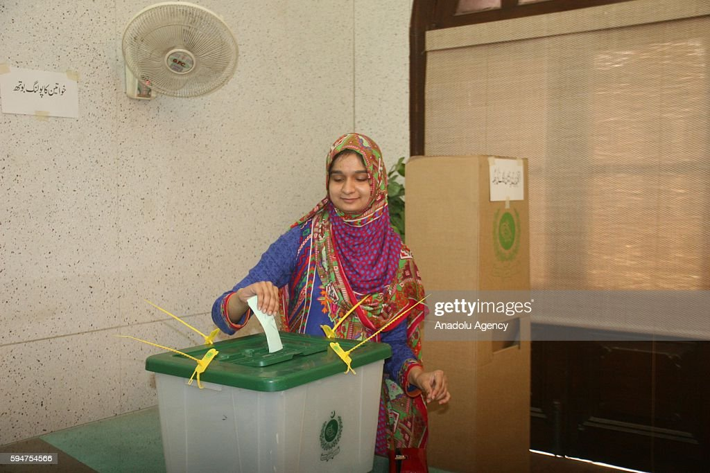 Pakistani woman casts her ballot at a polling station within mayoral election in Karachi Pakistan on August 24 2016