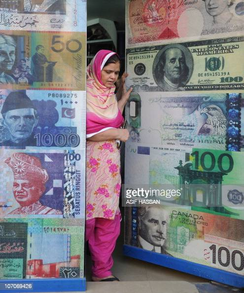 A Pakistani woman leaves a currency exchange shop in Quetta on November 22 2010 The European single currency and stock markets rallied on November 22...
