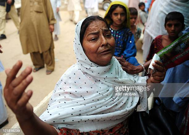 A Pakistani woman mourns the killing of a victim of a shooting outside a hospital in Karachi on August 18 2011 At least 30 people died in overnight...