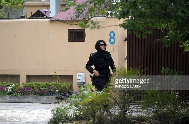 A Pakistani woman police commando arrives outside the house where family members of slain AlQaeda chief Osama bin Laden are believed to be held in...