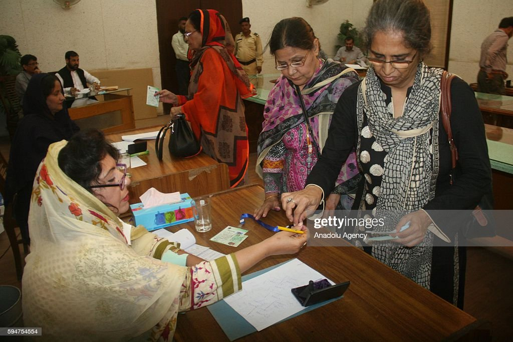 Pakistani women arrive at a polling station to cast their votes within mayoral election in Karachi Pakistan on August 24 2016