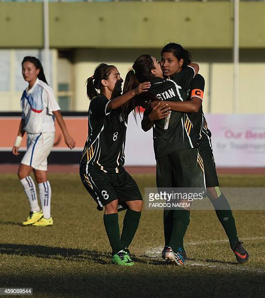 Pakistani women football players celebrate with captain Hajra Khan a goal against the Bhutan team during their match in the 3rd South Asian Football...