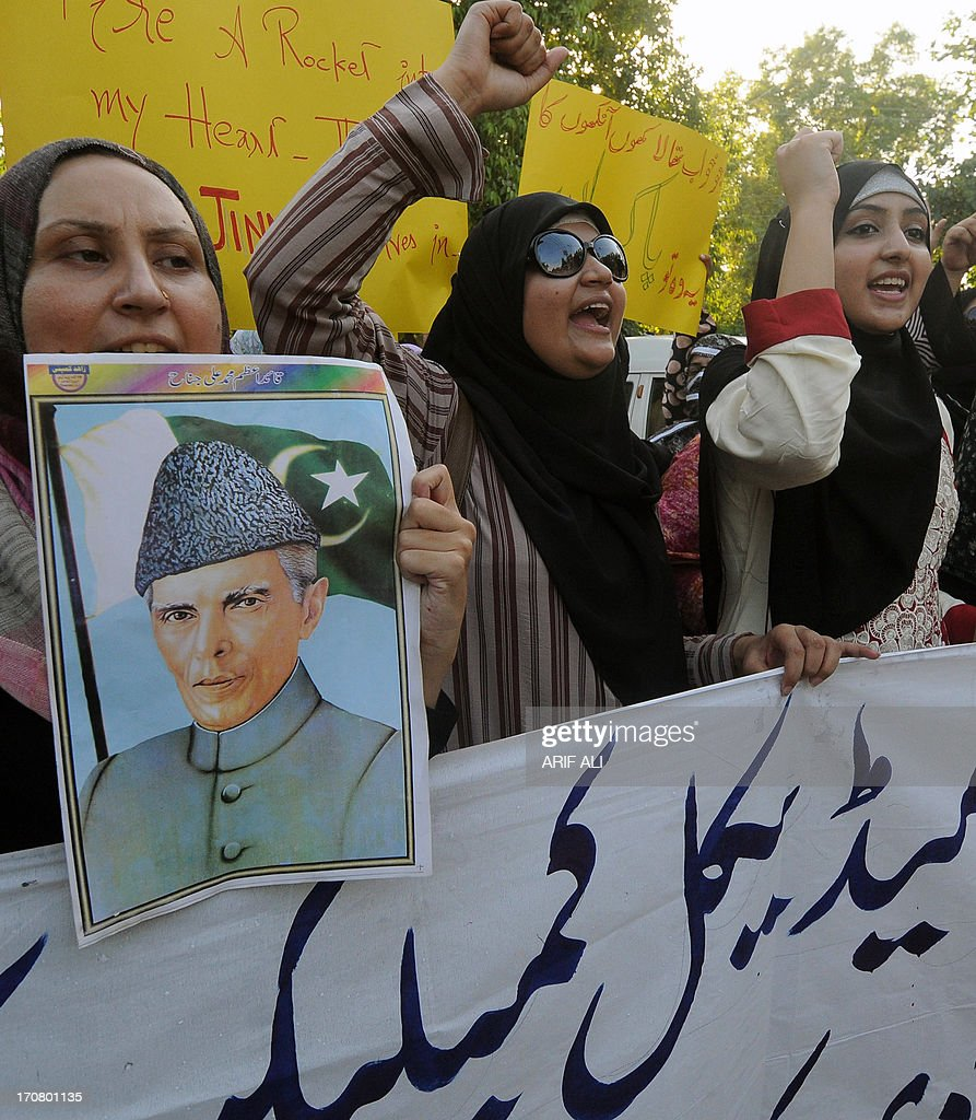 Pakistani women hold placards as they shout slogans during rally in Lahore on June 18, 2013, to protest for the bombing in Quetta and against militants who destroyed a historic building linked to Pakistan's founding father Mohammad Ali Jinnah. At least 25 people were killed June 15 when militants blew up a bus carrying female students in Quetta, capital of restive Baluchistan province, and then stormed a hospital where survivors had been taken for treatment. AFP PHOTO/Arif ALI