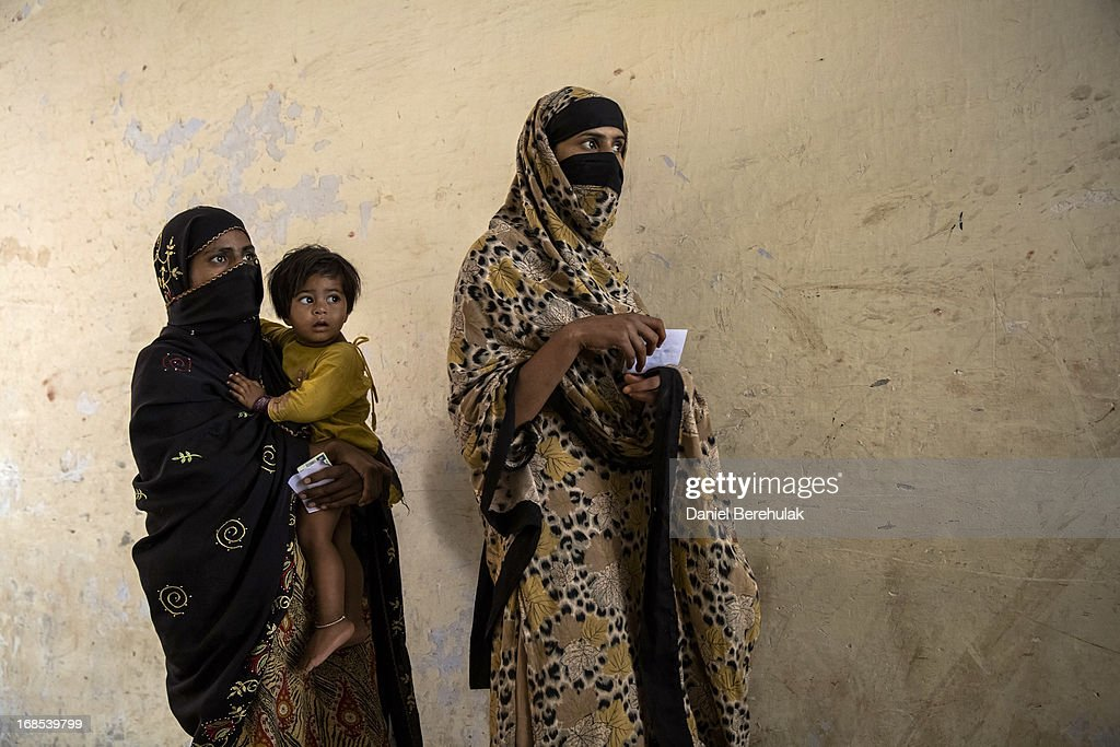 Pakistani women queue to cast their vote at a polling station on May 11, 2013 on the outskirts of Lahore, Pakistan. Millions of Pakistanis cast their votes in parliamentary elections held today on May 11. It is the first time in the country's history that an elected government will hand over power to another elected government.