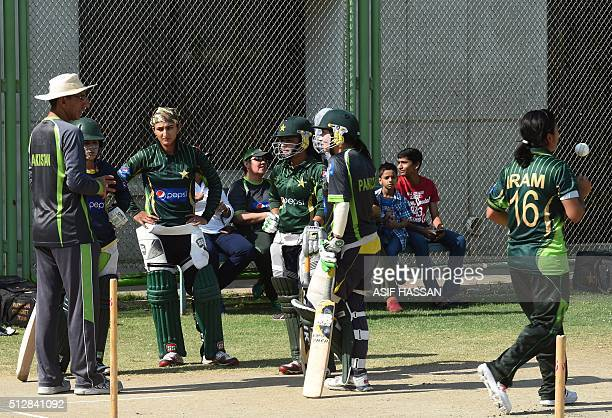 Pakistani women's cricket team coach Mohtashim Rasheed gives tips to players on the first day of a training camp in Karachi on February 28 2016 Sana...