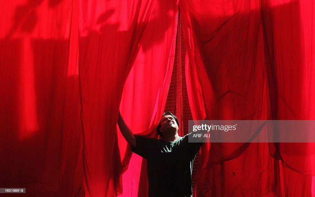A Pakistani worker dries fabric that was dyed at a factory in Lahore on March 6, 2013.Pakistan is the world's fourth-largest producer of cloth, and the industry accounts for 60 percent of export revenue according to official data.