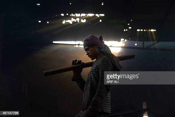 A Pakistani worker takes a moment's break at a steel mill in an industrial area of Lahore on April 30 2014 the eve of International Labour Day...