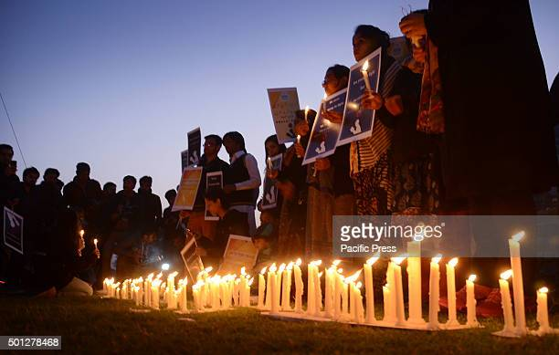 Pakistani workers of civil society 'Bargad' and students from different colleges universities hold a candle light vigil in memory of students...