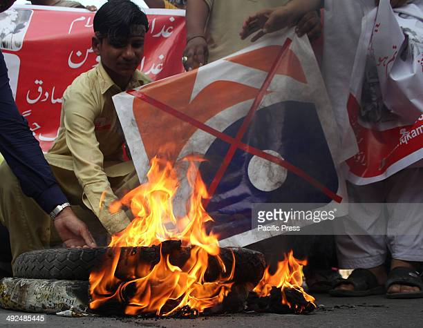 Pakistani workers of Religious party burning the LOGO of a famous TV channel Geo News in Lahore The Geo programme Utho Jago Pakistan made a critical...