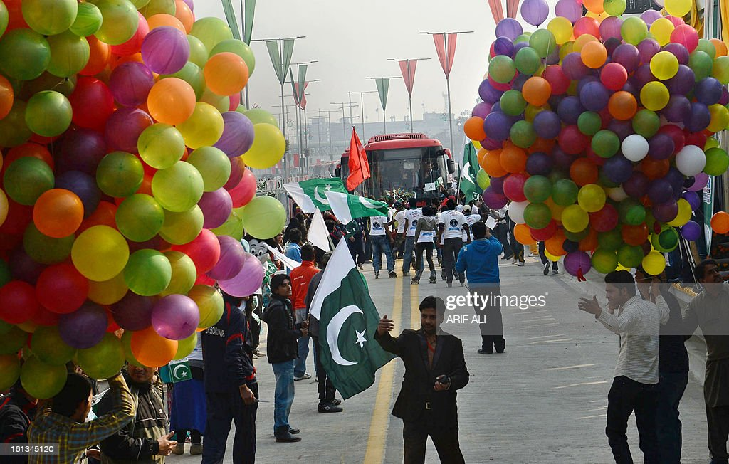 Pakistani youth hold balloons during the launch of the Metro Bus system in Lahore on February 10, 2013. Authorities in Pakistan on Sunday launched a 'Metro Bus' system in the second largest city, Lahore, the restive country's first major urban public transport scheme. AFP PHOTO/Arif ALI