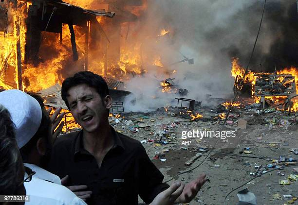 A Pakistani youth mourns as shops burn at a market following a deadly car bomb blast in Peshawar on October 28 2009 A car bomb destroyed a packed...
