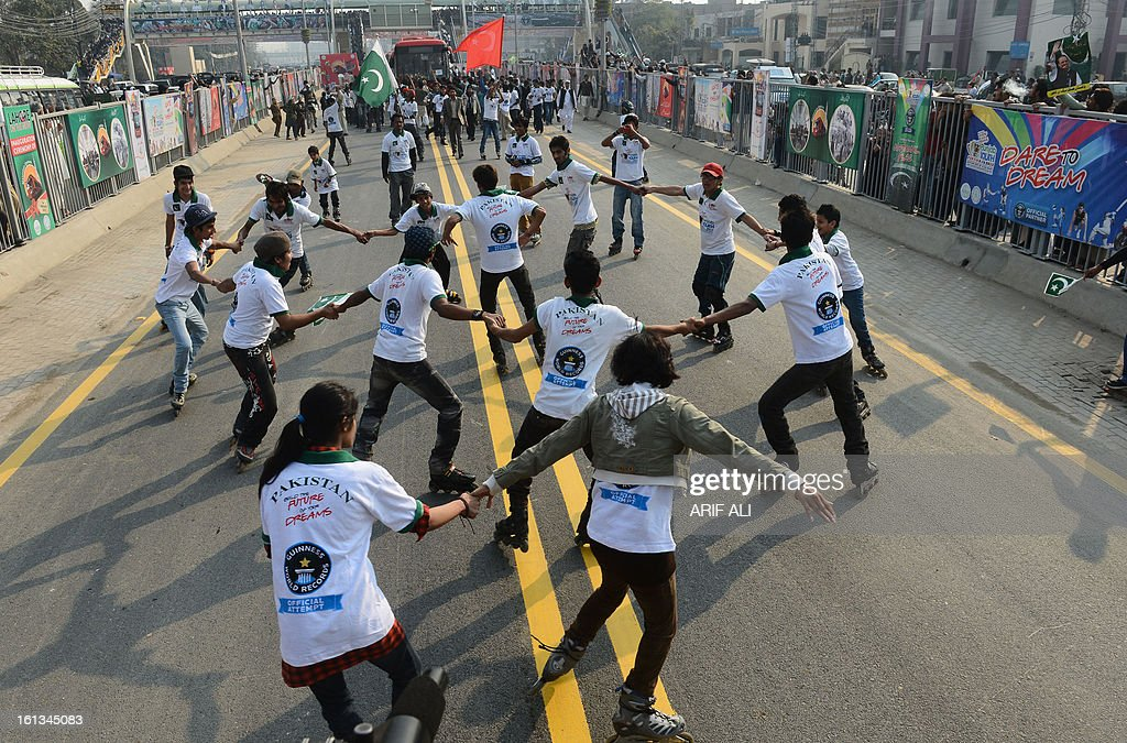 Pakistani youth perform during the launch of the Metro Bus system in Lahore on February 10, 2013. Authorities in Pakistan on Sunday launched a 'Metro Bus' system in the second largest city, Lahore, the restive country's first major urban public transport scheme. AFP PHOTO/Arif ALI