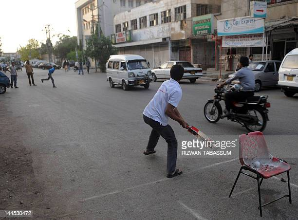 Pakistani youths play cricket on a street in Karachi on May 15 2012 Pakistan's 180 million people are well known for being cricketmad but the nation...