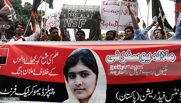 Pakistani youths shouts slogans during a protest against the assassination attempt by Taliban on child activist Malala Yousafzai in Lahore on October...
