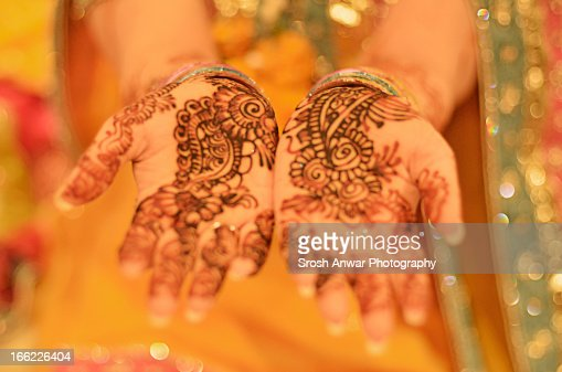 Pakistani/Indian Bride with hennaed hands : Stock Photo