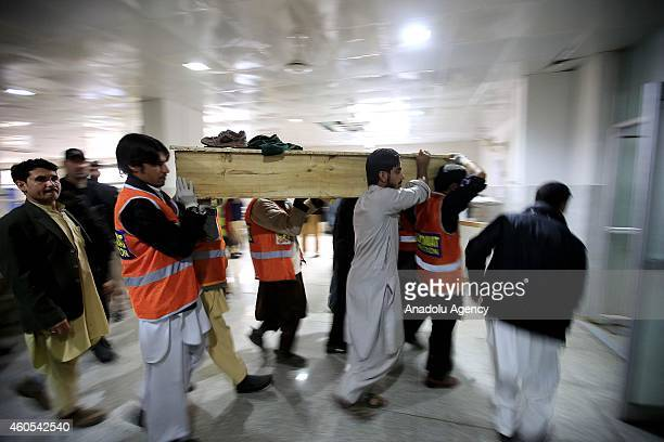 Pakistanis carry the coffin of a student killed when Taliban gunmen stormed a military school in the northwestern Pakistani city of Peshawar at Lady...