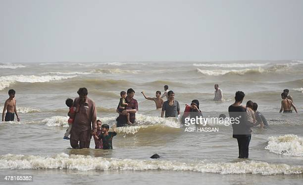 Pakistanis cool off at a beach on the Arabian Sea during a heatwave in Karachi on June 23 2015 More than 500 people have died from a threeday...