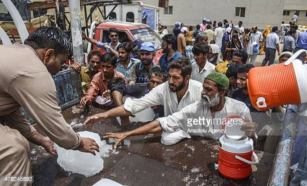 Pakistanis receive ice outside a hospital during a heatwave in Karachi Pakistan on June 24 2015 More than 1000 people have been killed over five days...