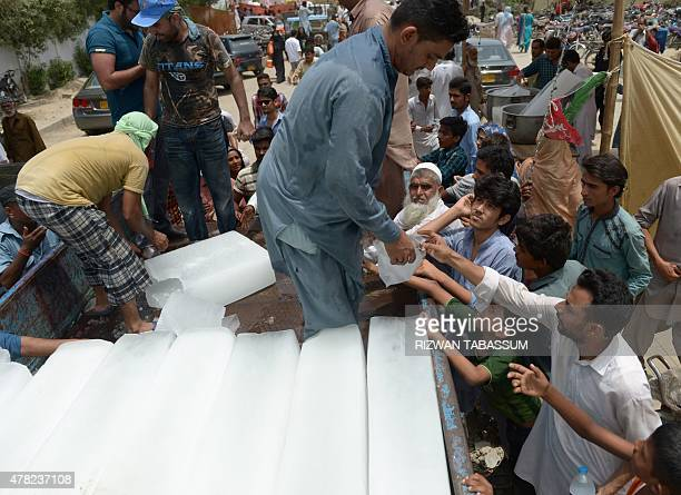 Pakistanis receive ice outside a hospital during heatwave in Karachi on June 24 2015 Nearly 700 people have died in a severe threeday heatwave in...