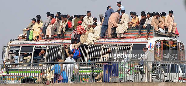 Pakistanis ride on the roof of an overcrowded bus as they return to their hometowns to celebrate Eid alAdha in Lahore on November 16 2010 The annual...