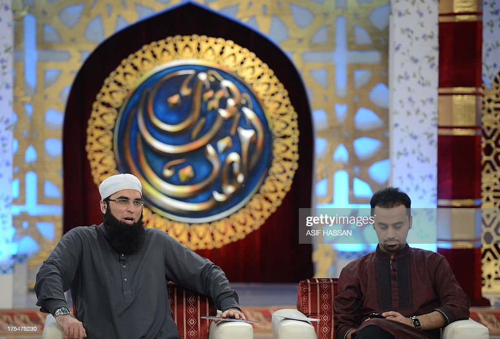 Pakistan-religion-media-Islam,FOCUS by Guillaume Lavallee In this photograph taken on August 1, 2013, Pakistani television show hosts Junaid Jamsheed (L) and Wasim Badami present an Islamic quiz show Shan-e-Ramadan in Karachi. In the battle for TV ratings, Pakistan's top channels are making money out of Ramadan by broadcasting round-the-clock chat shows mixing prizes, charity and prayer. AFP PHOTO / ASIF HASSAN