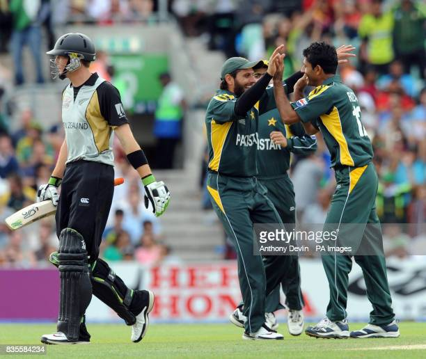 Pakistan's Abdul Razzaq celebrates with teammate Shahid Afridi after taking the wicket of New Zealand's Martin Guptill during the ICC World Twenty20...