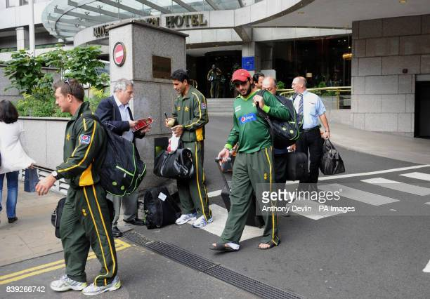 Pakistan's Abdul Razzaq signs autographs as Shahid Afridi and team mates leave the Royal Garden Hotel in Kensington London
