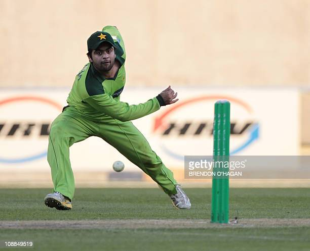 Pakistan's Ahmed Shehzad throws the ball at the stumps for an unsuccessful run out during the one day international match against New Zealand in...