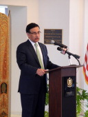 Pakistan's ambassador to the United States Husain Haqqani addresses a memorial service in honor of slain minister for minorities Shahbaz Bhatti at...