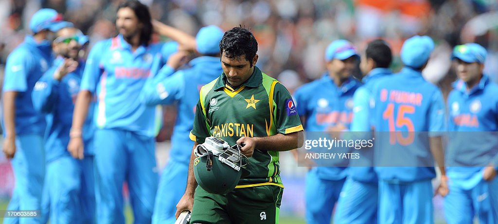 Pakistan's Asad Shafiq leaves the field after getting out during the 2013 ICC Champions Trophy cricket match between Pakistan and India at Edgbaston in Birmingham, central England, on June 15, 2013. AFP PHOTO/ANDREW YATES == RESTRICTED TO EDITORIAL USE ==