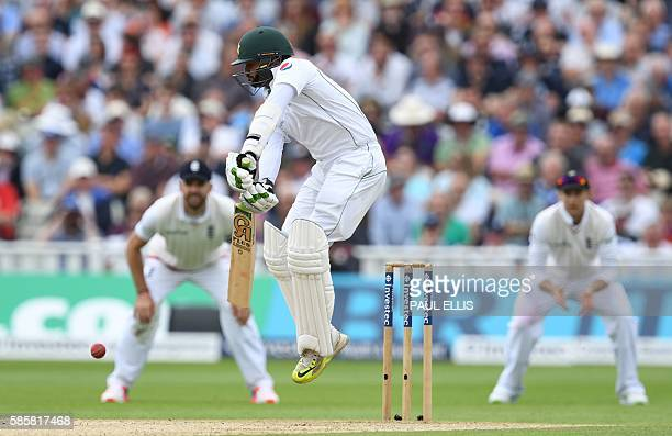 Pakistan's Azhar Ali jumps as he defends his stumps during play on the second day of the third test cricket match between England and Pakistan at...