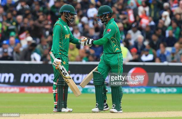 Pakistan's Babar Azam and Pakistan's Mohammad Hafeez touch gloves during their partnership during the ICC Champions trophy match between Pakistan and...