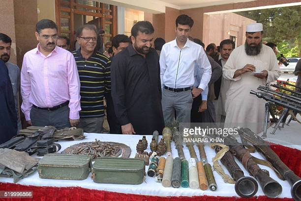 Pakistan's Balochistan province Home Minister Sarfaraz Bugti inspects recovered wepons following a press conference in Quetta on April 9 2016...